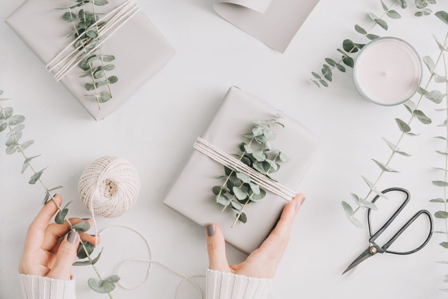Girl's hands hold a gift box with minimalist style wrapping design. The concept of Christmas and... by Edalin Photography on 500px.com