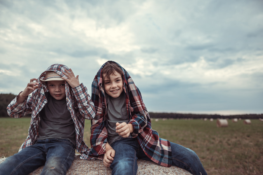 Two little brothers on a sloping field by Irina Polonina on 500px.com