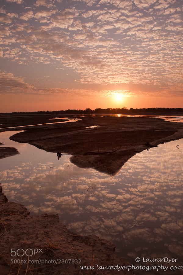 The sunrise as seen over a portion of the Luangwa River in South Luangwa National Park.