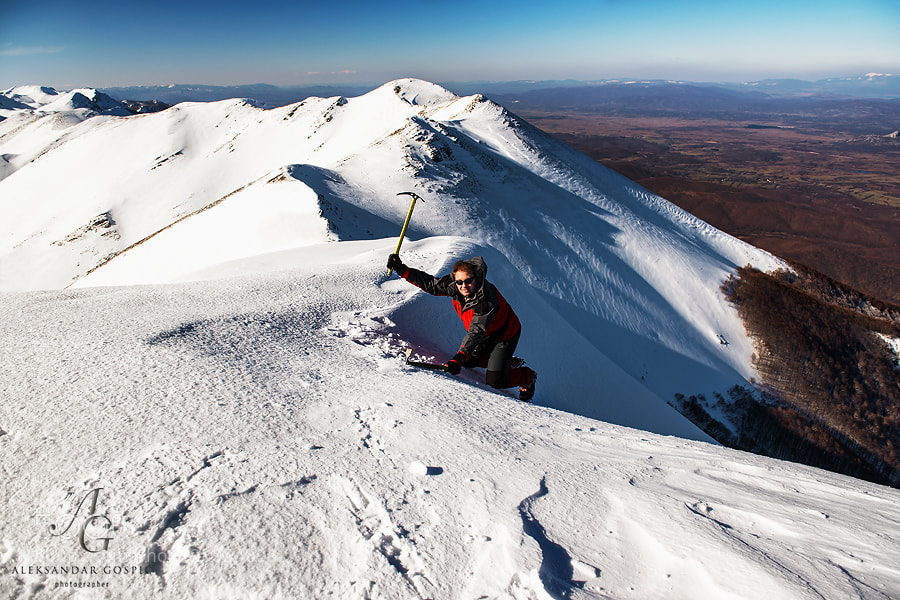 Me on the top of Sveto Brdo (1751m) and steep couloir on the Lika side (continental side) of the Velebit mountain