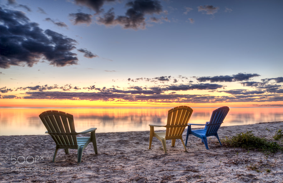 It was a great way to spend a summer evening in Door County, Wisconsin.  Even better way to watch a sunrise over Lake Michigan.  You can purchase this photo here: http://fineartamerica.com/featured/3-chairs-sunrise-scott-norris.html.