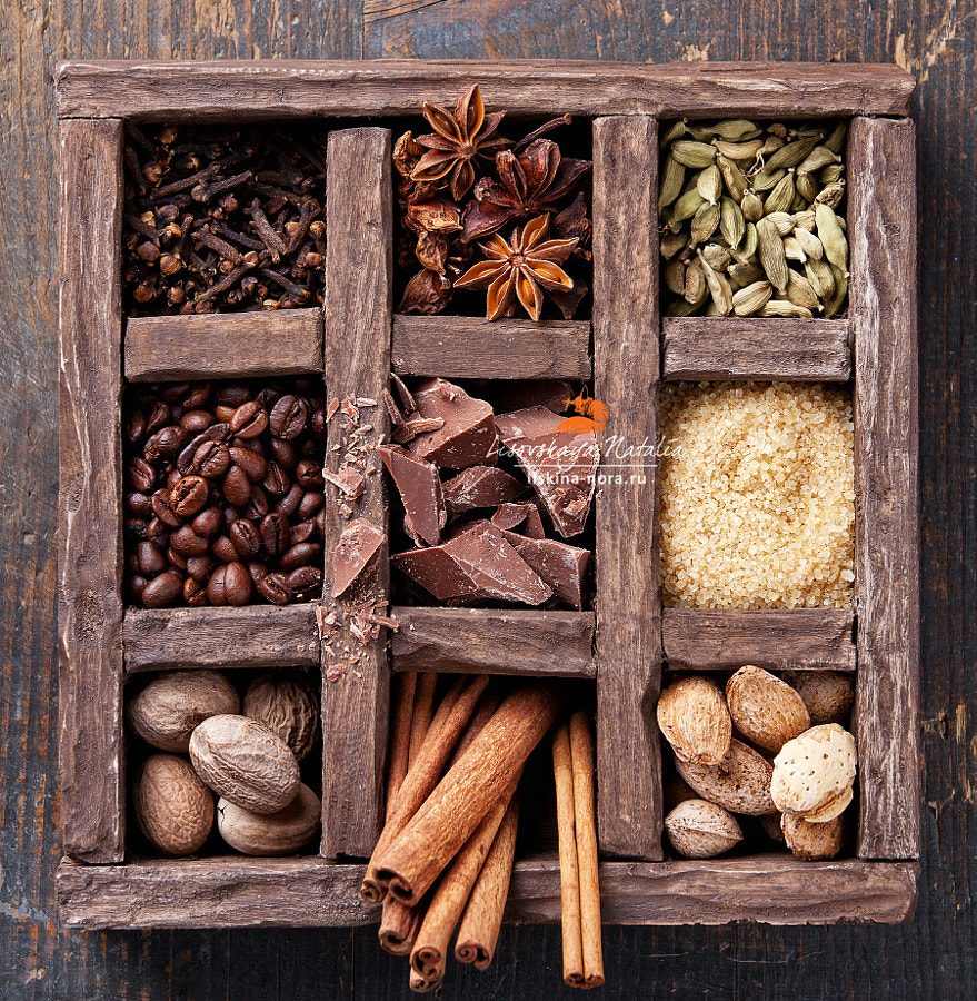 Assortment of spices and coffee beans in wooden box