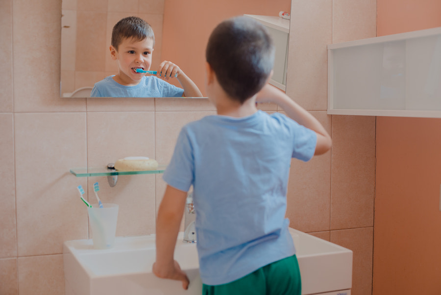 Happy kid or child brushing teeth in bathroom. by Yuliya  Shangarey Shangarey on 500px.com