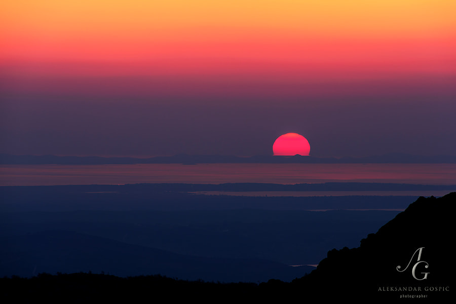 End of the day observed from Velebit mountain as Sun slowly sinks into the Adriatic sea
