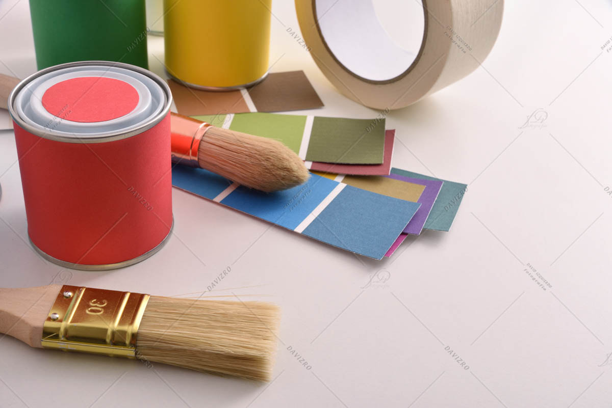 Tools for painting houses on white table elevated view