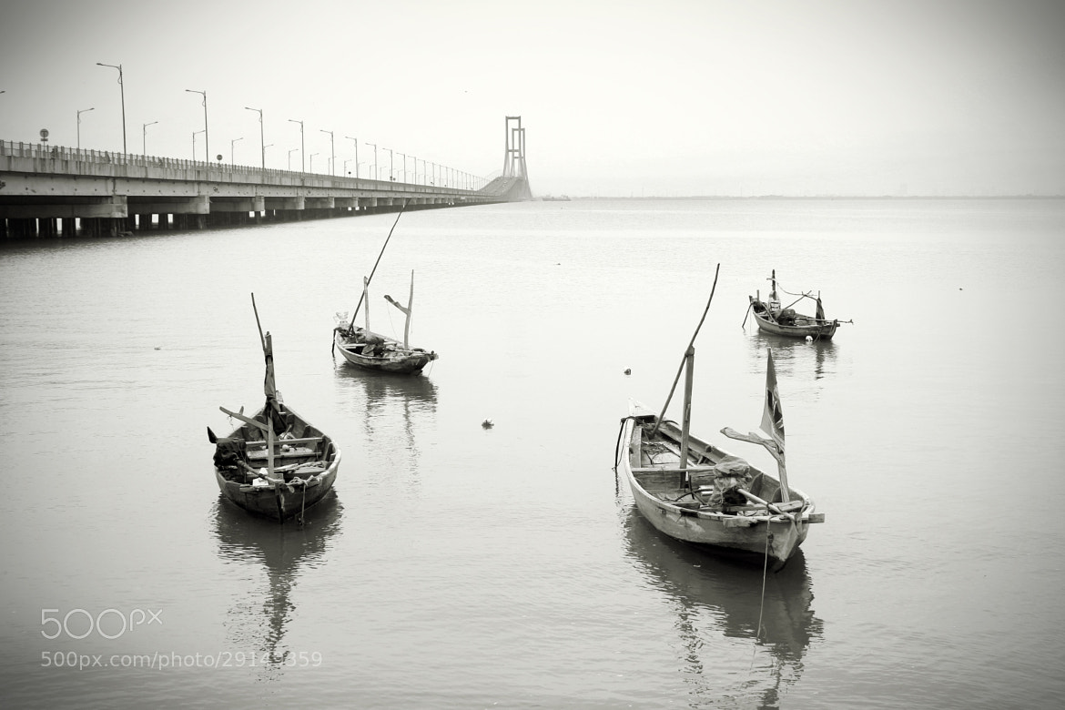 Photograph The Dusk, The Bridge, and the empty boat by alvein yudhaputra on 500px