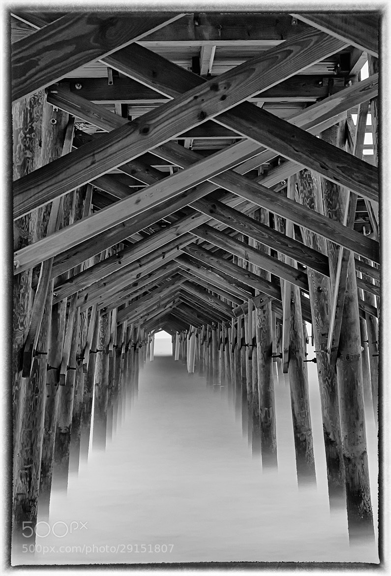 Photograph Under The Pier, 180 second exposure by James Hilliard on 500px