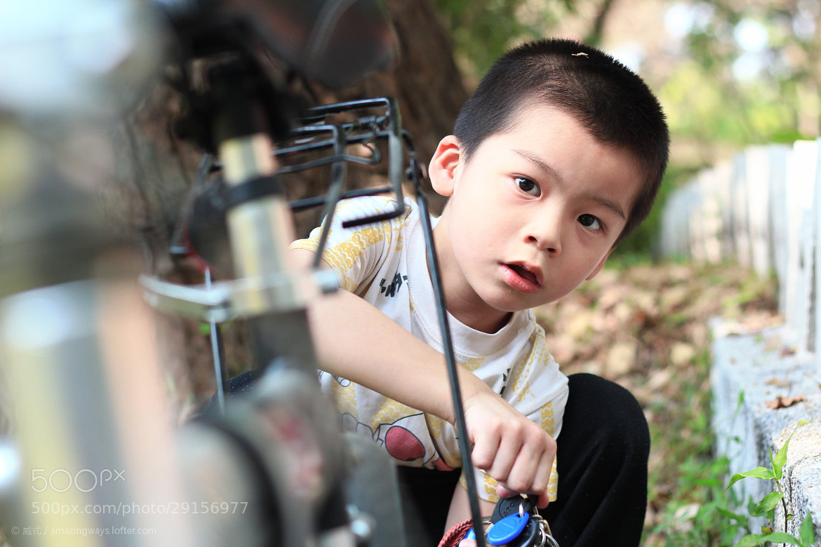 Photograph  How curious can one guy be?#March 09# Kid handle ... by William Chan on 500px