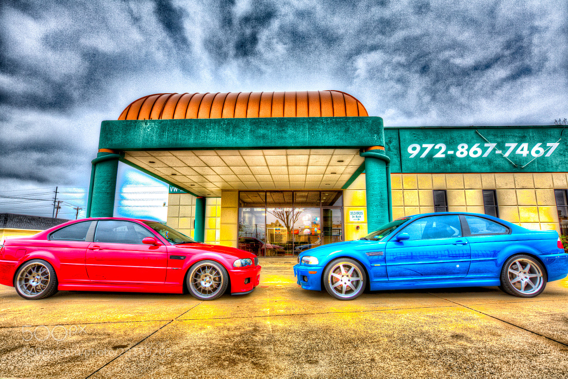 Photograph Laguna Seca Blue and Red BMW M3s by Nerces Mavelian on 500px