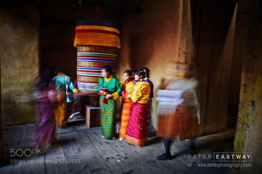 Photograph Jakar Girls in Doorway by Peter Eastway on 500px