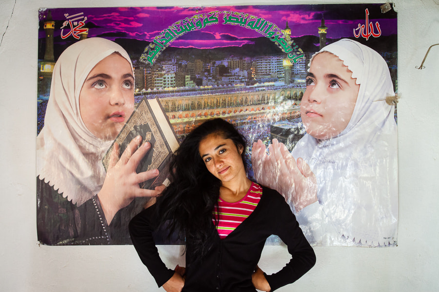 Photograph Tajik woman in front of Muslim piety poster by Damon Lynch on 500px