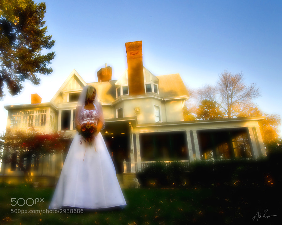 Bride in front of house