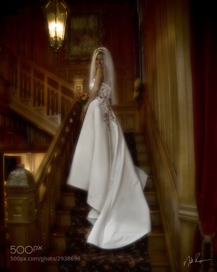 Bride poses on staircase