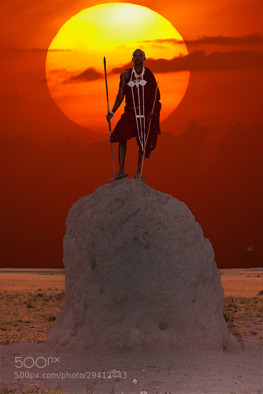 Photograph Maasai warrior stands atop a termite mound at sunset _MG_5894 by Charlie Summers on 500px