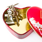 Постер, плакат: A golden stainless stell heart with a miniature heart keychain i