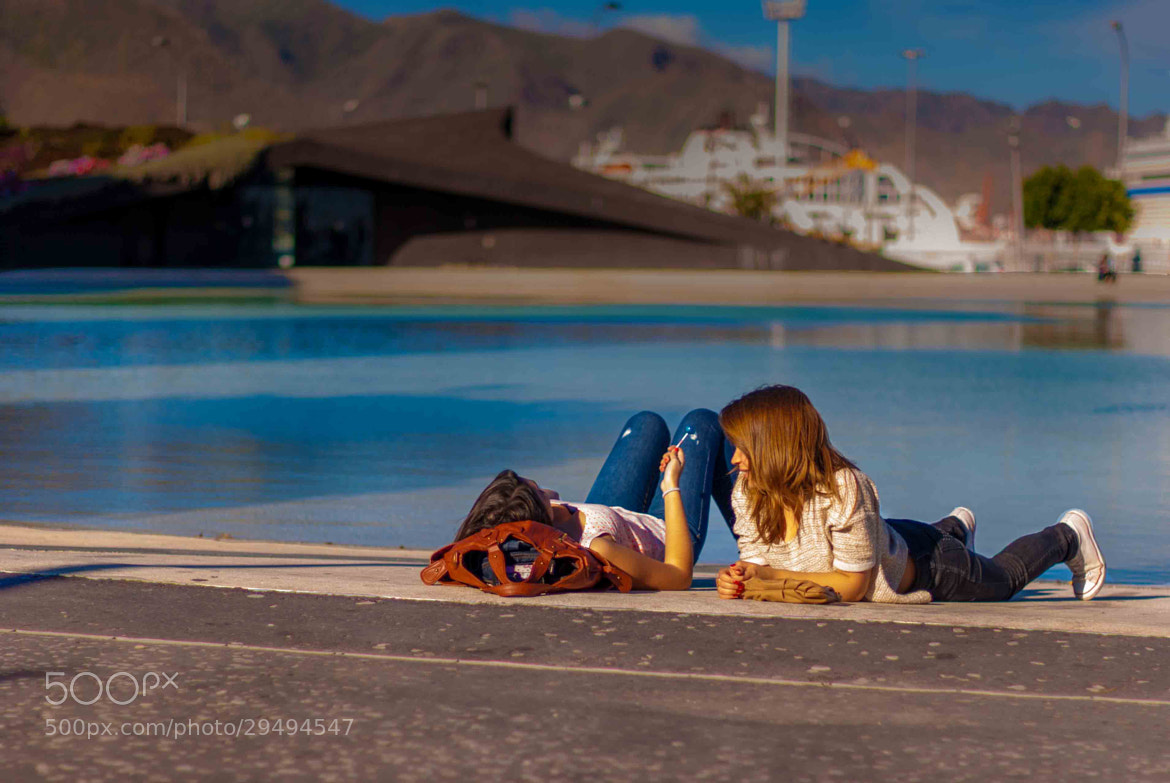 Photograph Girltalk in the city beach by Dinesh Harjani on 500px