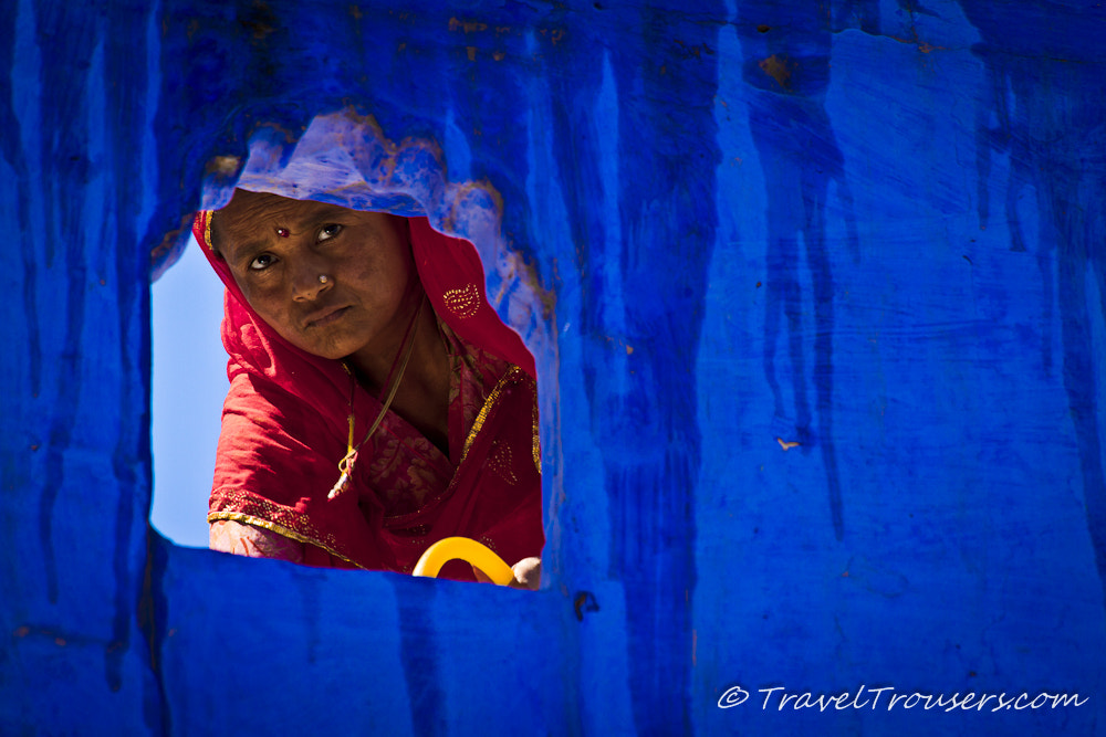 Photograph Woman in red watering plants in the blue city of Jodhpur by Travel Trousers on 500px