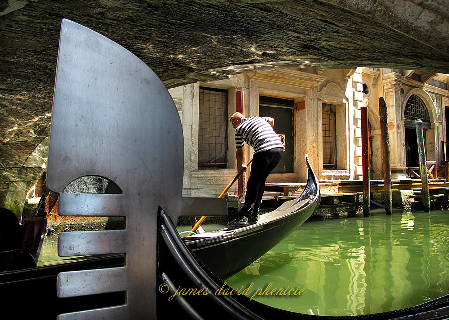 Rowing past a gondola.