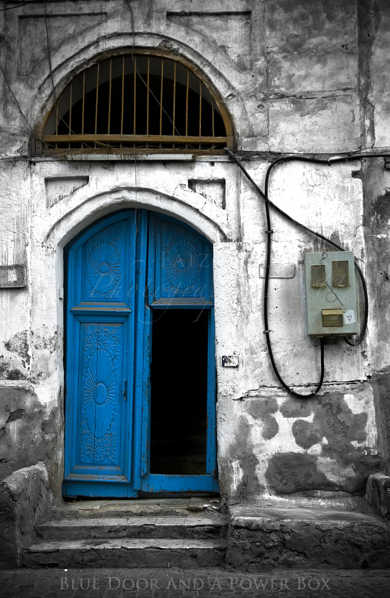 Photograph  A Blue Door And a Power Box by Fayiz Melibary on 500px