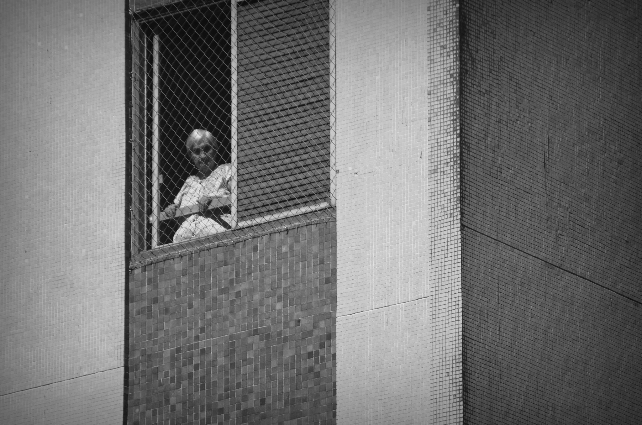 Photograph Lone Woman in the Window by Paulo Zerbato on 500px
