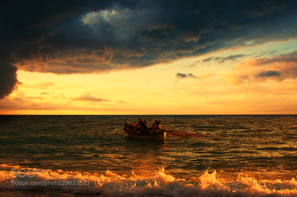 Photograph Fishermen at work before storm by Stefano Crea on 500px
