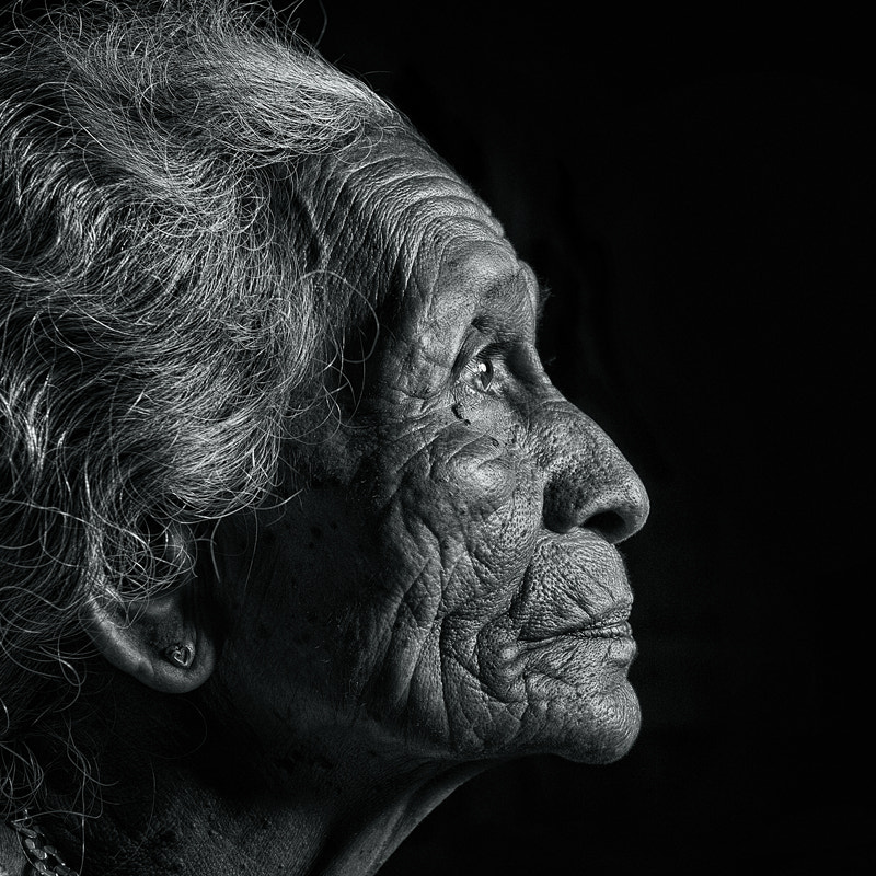 the portrait of an old malay woman