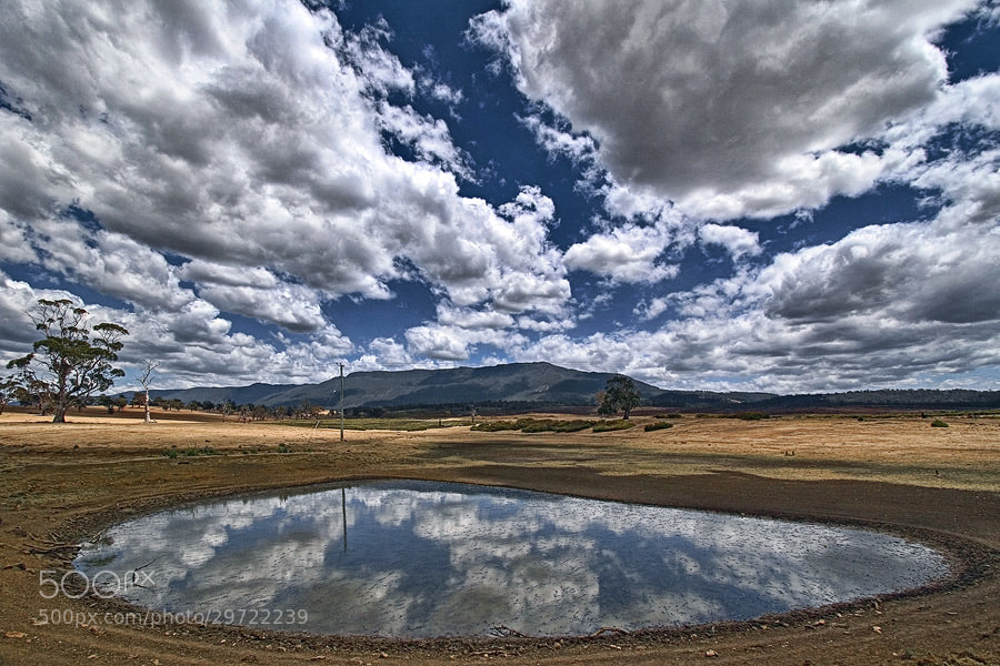 Photograph Clouds in the Dam by Peter Daalder on 500px