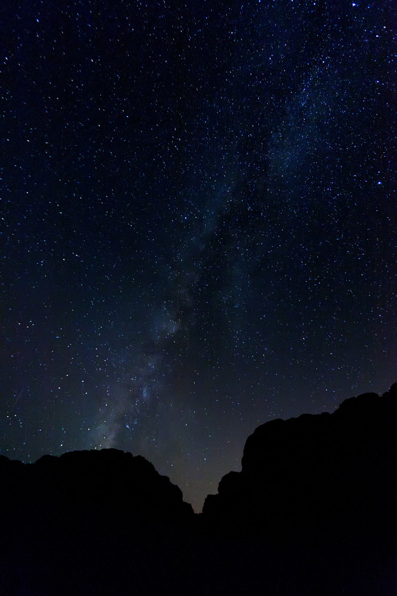 Photograph The milky way and stars behind the desert mountains by Richard Whitcombe on 500px