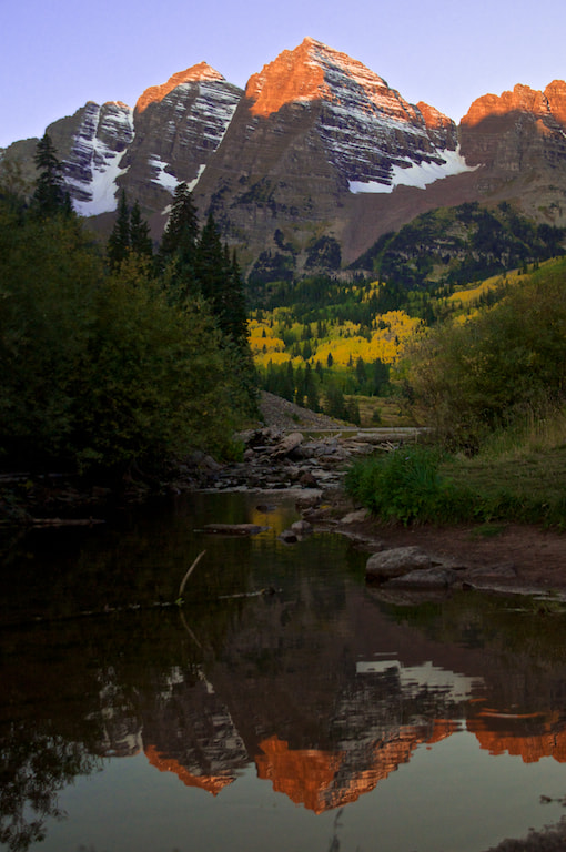 I camped at Maroon Bells near Aspen, CO and got up before dawn to get this shot. The lake was too windy for a nice reflection so I found a spot in the stream below the beaver dam to get this. There were only about 150 other photographers there!