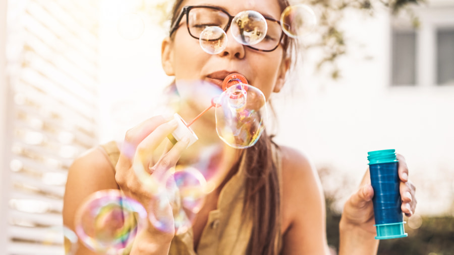 Happy girl blowing soap bubbles outdoor by Alessandro Biascioli on 500px.com