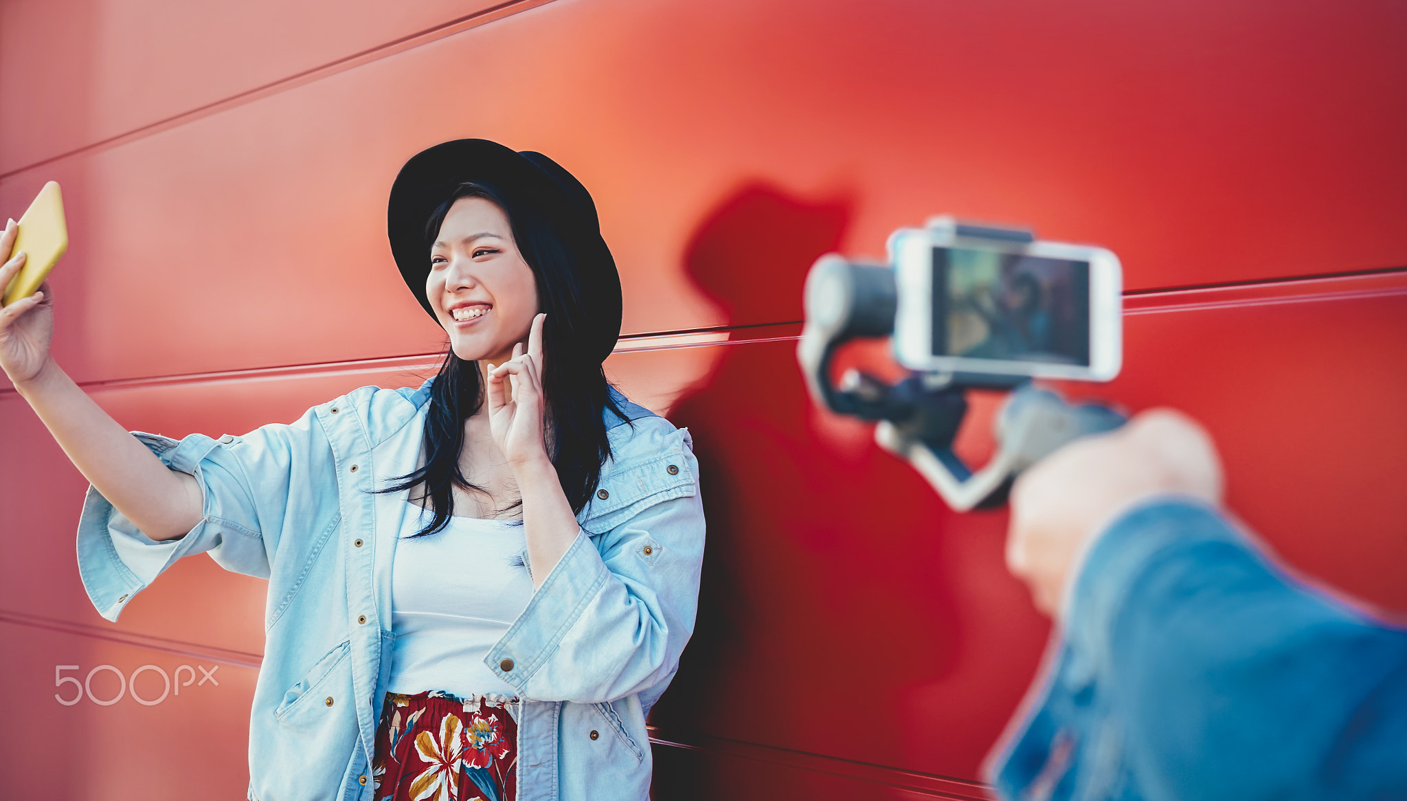 Asian fashion girl vlogging and using mobile smartphone outdoor