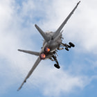 F/A-18F Super Hornet climbs nearly straight up.