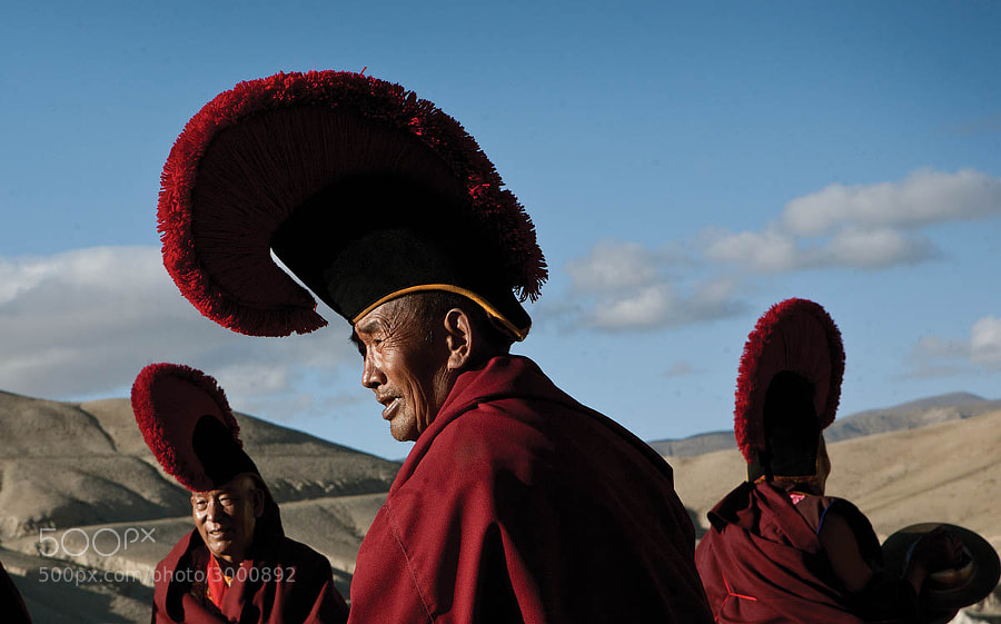 A group of senior monks gather for a ceremony on a field outside of Lo Manthang.