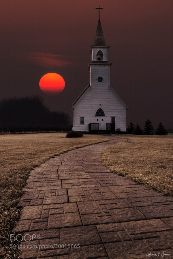 """Sun setting behind the 1902  Delafield Church. Taken Easter Sunday 3-31-13 at Fort Belmont in Jackson, Minnesota. 300mm  f/16 1/250 100iso used for the sky.     Please visit my website for prints and products  ---<a href=""""www.homegroenphotography.com"""" rel=""""nofollow"""">www.homegroenphotography.com</a> facebook - <a href=""""http://www.facebook.com/HomeGroenPhotography"""" rel=""""nofollow"""">www.facebook.com/HomeGroenPhotography</a>"""