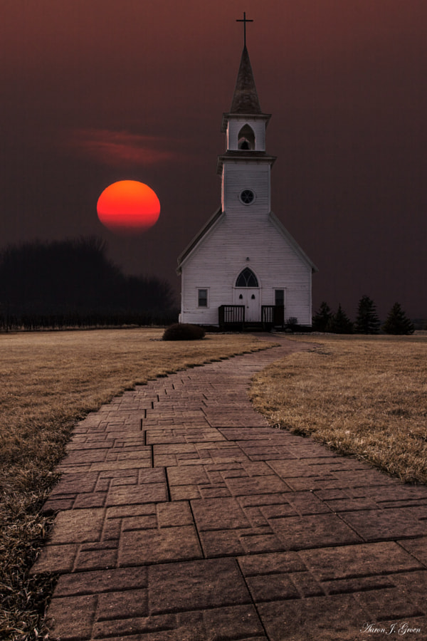 "Sun setting behind the 1902  Delafield Church. Taken Easter Sunday 3-31-13 at Fort Belmont in Jackson, Minnesota. 300mm  f/16 1/250 100iso used for the sky.     Prints - <a href=""http://homegroenphotography.com/"">HomeGroenPhotography.com</a>   facebook - <a href=""http://www.facebook.com/HomeGroenPhotography"">www.facebook.com/HomeGroenPhotography</a>"