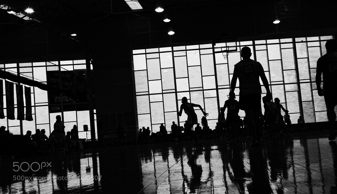 Photograph Silhouetted Netball Players by Ewan Arnolda on 500px