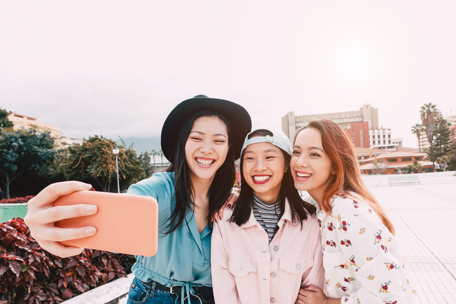 Happy Asian girls taking selfie with mobile smartphone outdoor by Alessandro Biascioli on 500px.com