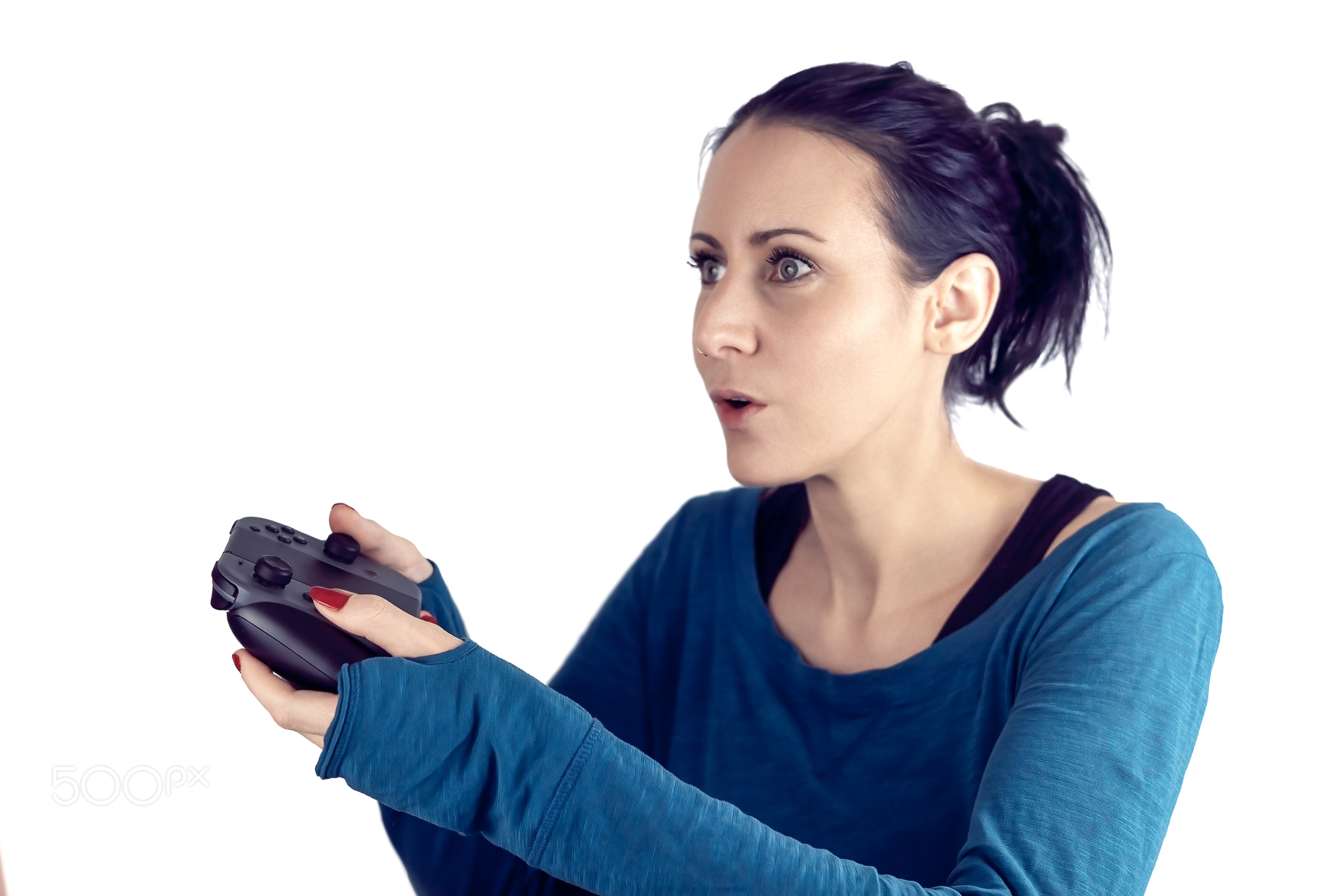 Young woman with blue sweater and red nail polish playing video game on wireless gaming...