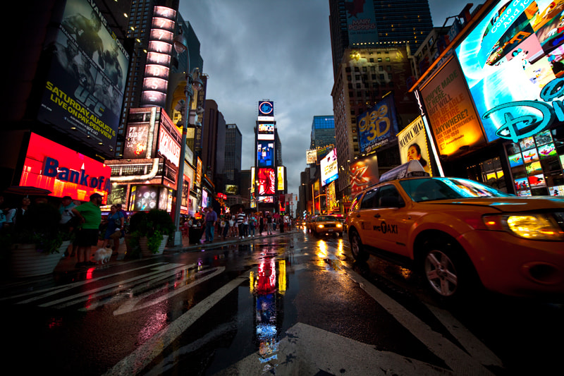 Photograph Rainy Times Square by Carlos Matesanz on 500px