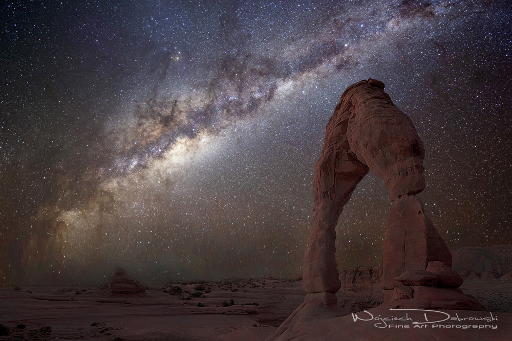 Photograph The night sky at Delicate Arch by Wojciech Dabrowski on 500px