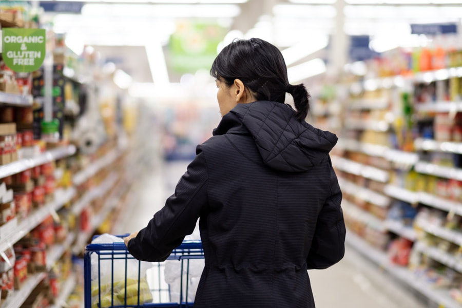 Asian woman doing groceries shopping in supermarket by Hieng Ling Tie on 500px.com