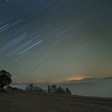 Startrails over a sea of fog