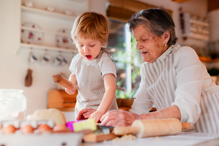 Senior grandmother with small toddler boy making cakes at home. by Jozef Polc on 500px.com