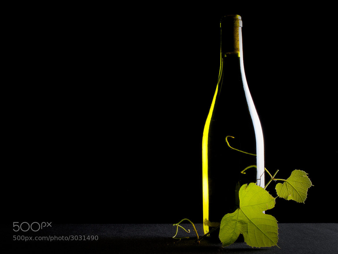 Photograph Bottle of white by Roeland Van de Velde on 500px