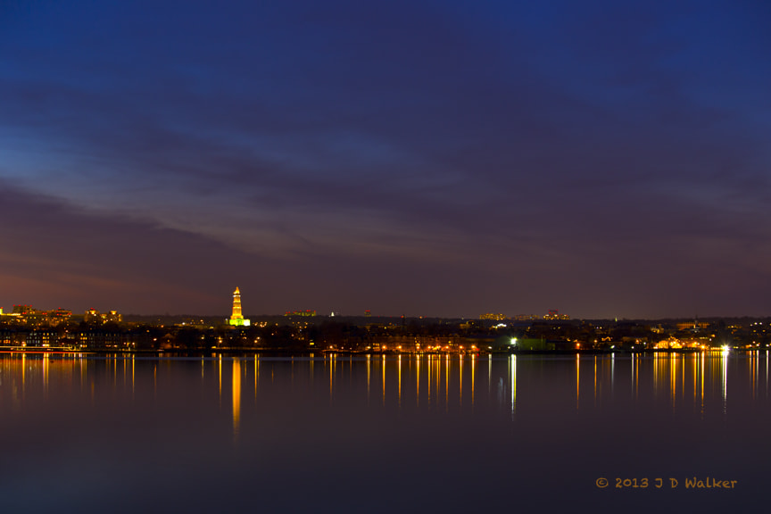 From Maryland, this is the Alexandria, Virginia, waterfront at night.  The tall red and green monument to the left is the Masonic George Washington Monument.