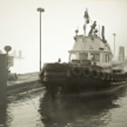 Cates Tug No. 4 in the fog at Lonsdale Quay, North Vancouver, Canada.