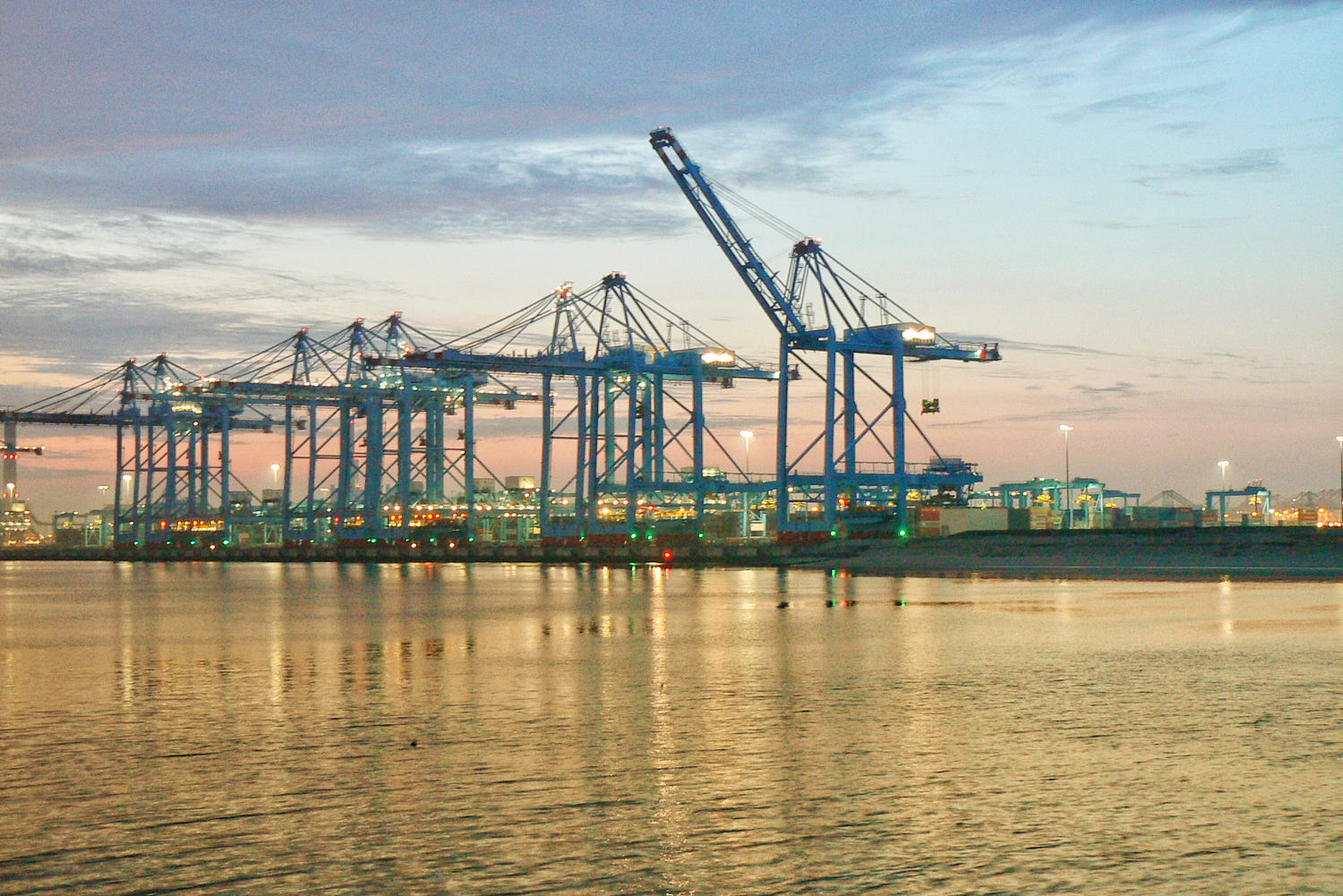 Sunrise over APM terminal, Amaliahaven Rotterdam by Dirk