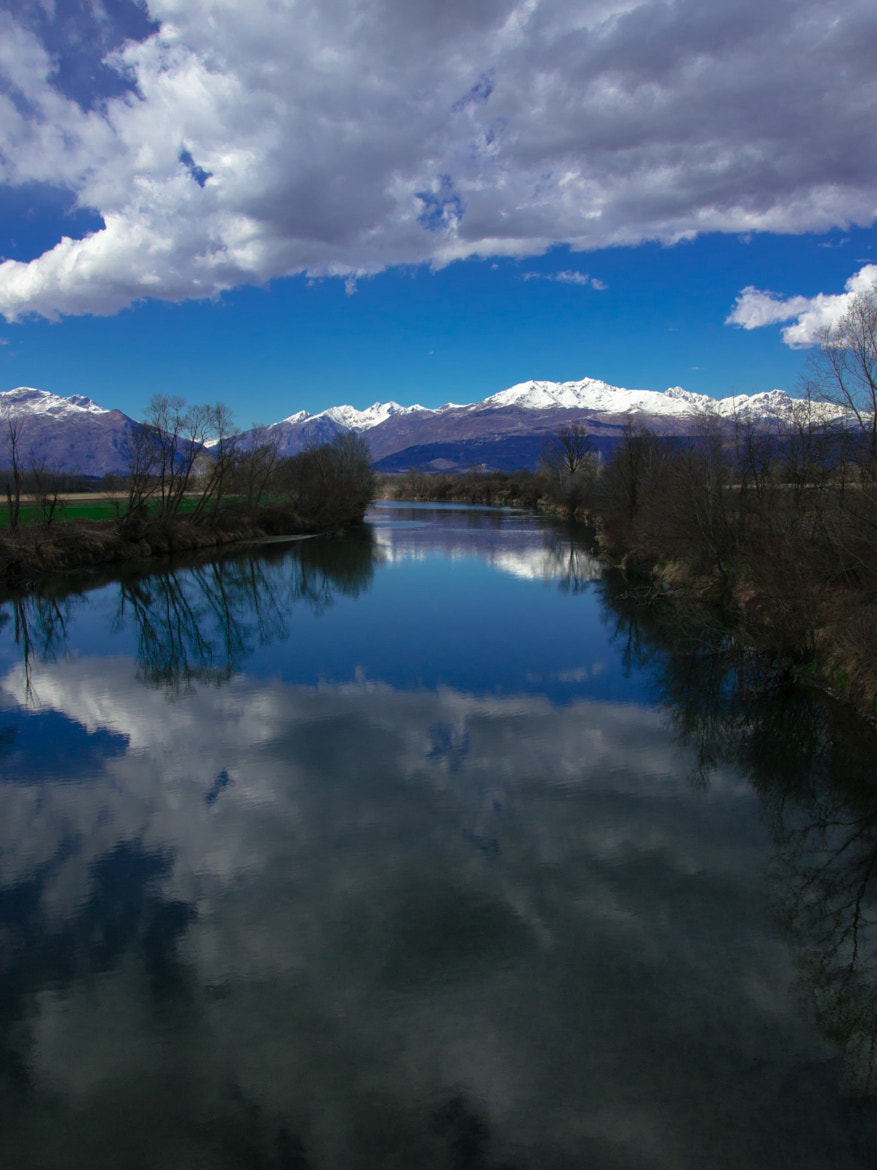Photograph River on a cloudy day by Enrico Patrizi on 500px
