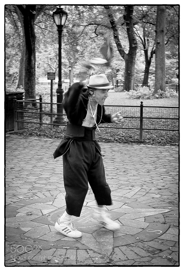 Man dances in Central Park, New York