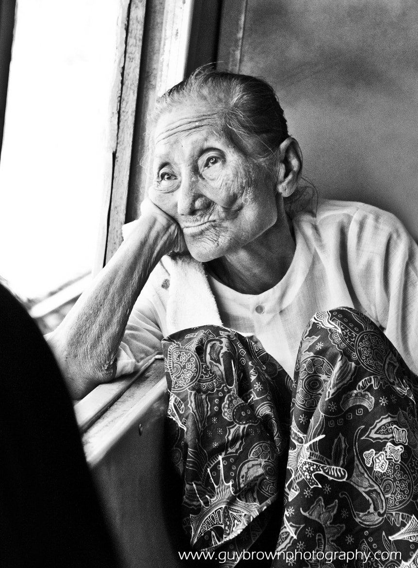 Photograph Old lady on the train, Myanmar by Guy Brown on 500px